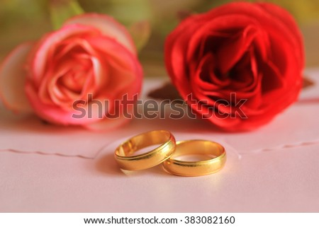 wedding rings with rose flowers