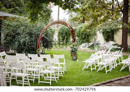 Wedding set garden wedding ceremony wedding stock photo royalty wedding set up in a garden wedding ceremony wedding decorationswedding archway with junglespirit Images