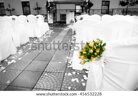 Wedding setting on ceremony with roses bouquet  - stock photo