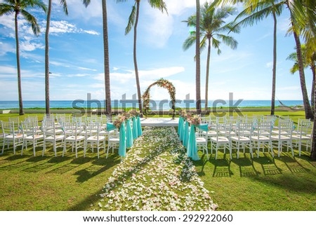 Wedding setting on the beach with palm tree garden - stock photo