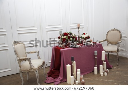 Wedding setting the table. Decorative elements. Wedding bouquet on the table.
