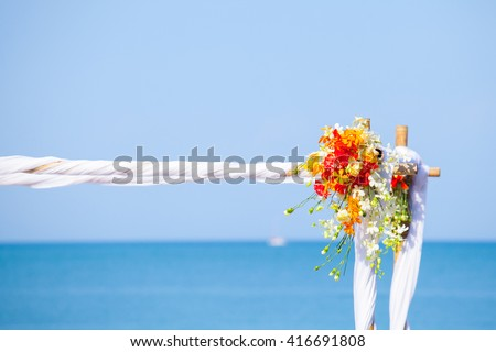 wedding setup,  arch,  decorated with flowers, beach wedding setup - stock photo