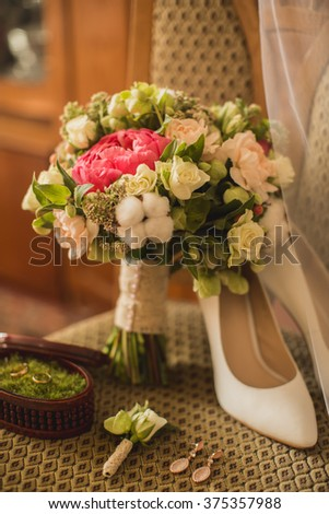 Wedding shoes and bouquet on a chair