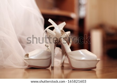 wedding shoes and white dress background