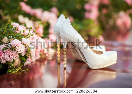 wedding shoes with a flowers - stock photo