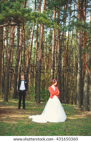 Wedding shot of bride and groom in park. Wedding couple just married with bridal bouquet.  Young couple in love outdoor. - stock photo
