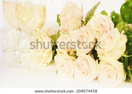 Wedding still life with roses and glass of champagne - stock photo