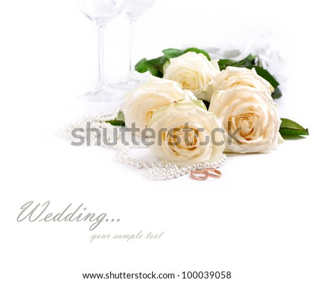 Wedding still life with white roses, golden rings an pearls - stock photo