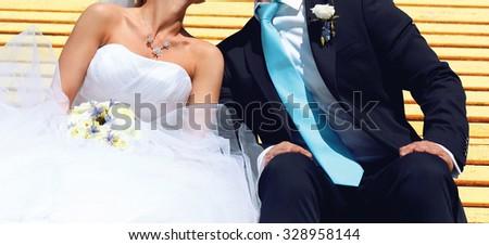 Wedding sweet couple, bride and groom kissing closeup - stock photo