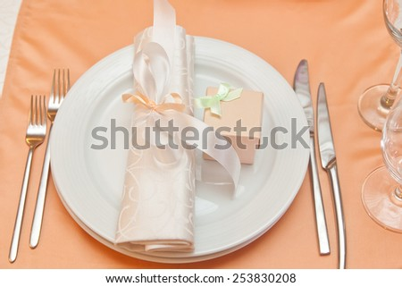 wedding table appointments closeup with gift box. table setting - stock photo