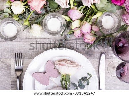 Wedding table appointments with beautiful decor and flowers. Valentines Day background