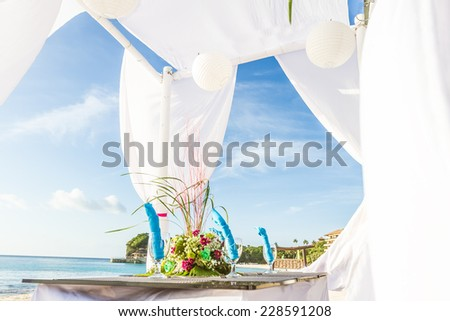 wedding table decoration and tableware, tropical background, romantic outdoor reception - stock photo