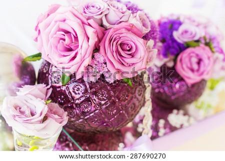 Wedding table decoration, wedding setting, wedding flowers on table, shallow depth of field. - stock photo