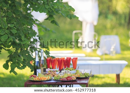 Wedding table. Exit ceremony outdoors. Holiday table. - stock photo