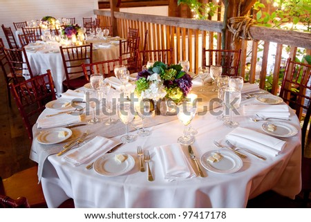 wedding table set for fine dining in a barn - stock photo