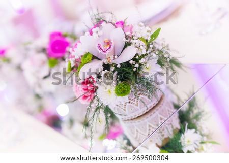Wedding table setting, wedding decoration, flowers, shallow depth of field. - stock photo