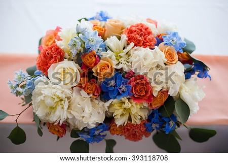Wedding table setting with flowers blue, white, red - stock photo