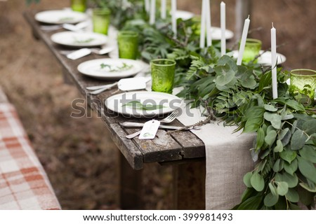 Wedding table setting with white plates and green glasses decorated with white candles green leaves & Wedding Table Setting White Plates Green Stock Photo (Edit Now ...