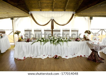 wedding table with decor at the celebration venue - stock photo