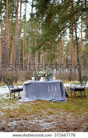 Wedding table with decoration in the forest
