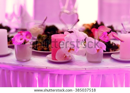 Wedding table with luxury floral decor in restaurant hall - stock photo