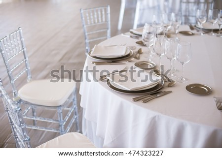 Wedding tables arranged for celebration at restaurant. Round served tables in pastel colors