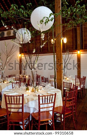 wedding tables set for fine dinning during a catered event - stock photo