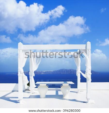 Wedding tent on Santorini island. Beautiful sky and horizon. - stock photo