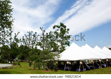 Wedding tent set up for an outdoor wedding or other catered event - stock photo