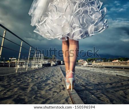 wedding the bride's legs - stock photo