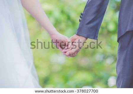 wedding theme, holding hands newlyweds a happy day