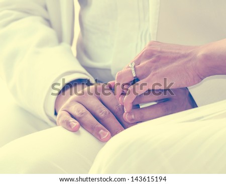wedding theme, holding hands with love - stock photo