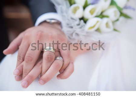 wedding theme, man and woman holding hands