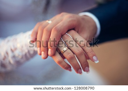 wedding theme, man and woman holding hands with a nice manicure neat - stock photo