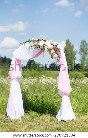 Wedding tradition arch with flower decor on blue sky background