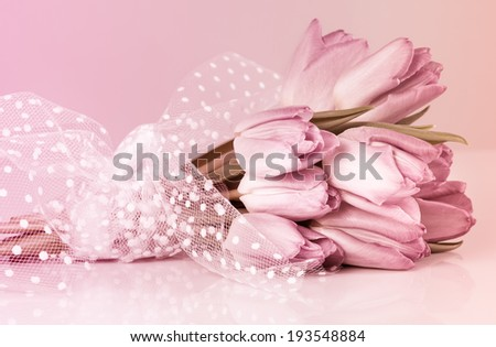 Wedding tulips bouquet with lace and pink filter - stock photo