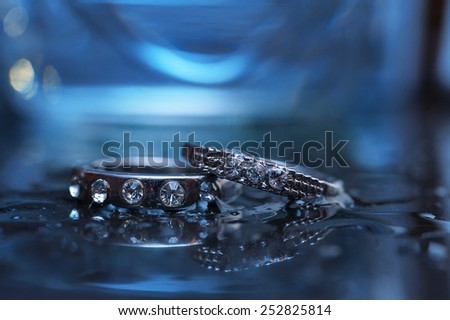 wedding two rings close-up in blue light. - stock photo