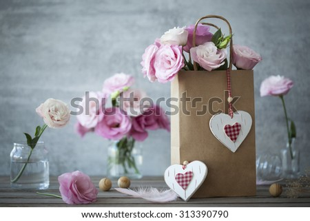 Wedding vintage background with pink flowers feathers and hearts - stock photo