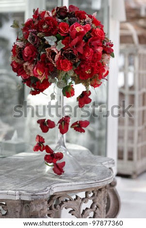 Wedding vintage table with red bouquet - stock photo