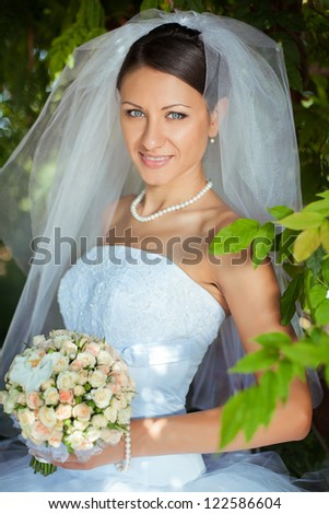 wedding: young bride posing in her wedding day - stock photo