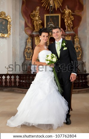 Wedding - young couple just married inside of church - stock photo