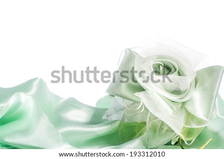 weddings favors on on the elegant backround fabric - stock photo