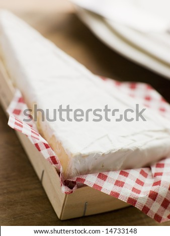 Wedge of Brie in a Wooden Box - stock photo
