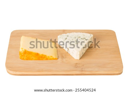 Wedge of Port Salut and Blue Cheese on a Cheese Board Isolated on a White Background. - stock photo