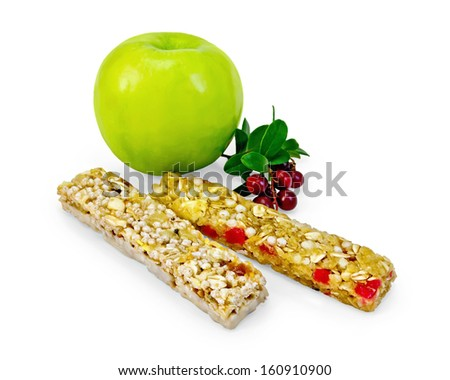 Wedges muesli, apple green, twig with leaves and berries lingonberries isolated on white background - stock photo