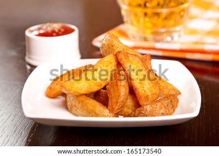 Wedges with herb rub and ketchup - stock photo