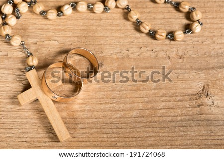 weding rings and rosary - stock photo