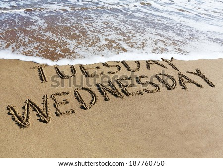 Wednesday is coming concept - inscription Tuesday and Wednesday written on a sandy beach, the wave is starting to cover the word Tuesday.  - stock photo
