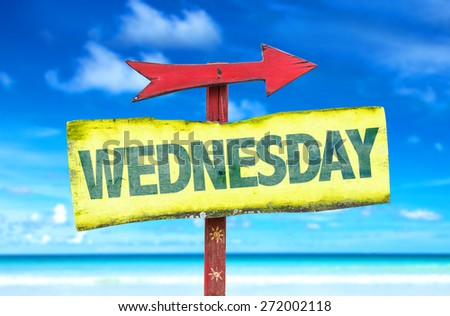 Wednesday sign with beach background - stock photo