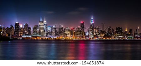 WEEHAWKEN, NJ - JUNE, 29: Midtown Manhattan skyline by night, during the Pride Weekend on June 29, 2013 in Weehawken, NJ. - stock photo
